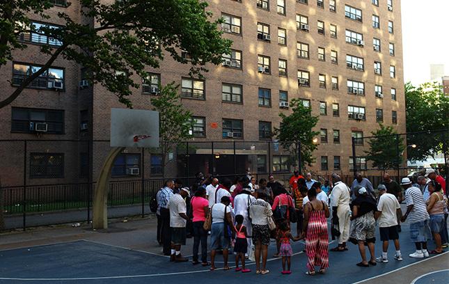 A community gathering outside of a housing development.