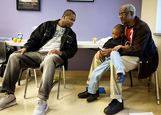 A father, grandfather, and son share a touching moment of connection.