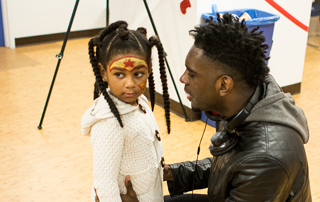 A participant and father at The Fortune Society, interacting with his daughter.