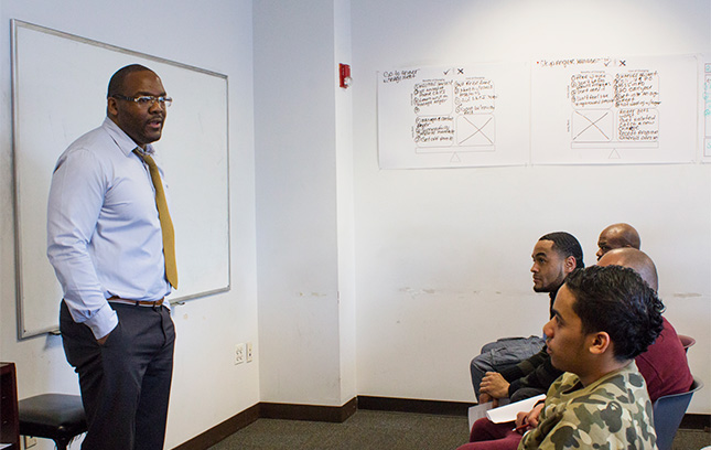 An Employment Services instructor at The Fortune Society teaching participants